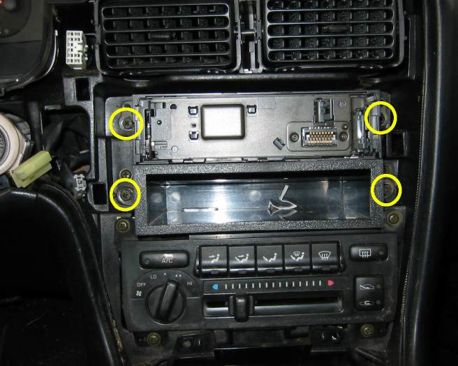 Four bolts secure the head unit