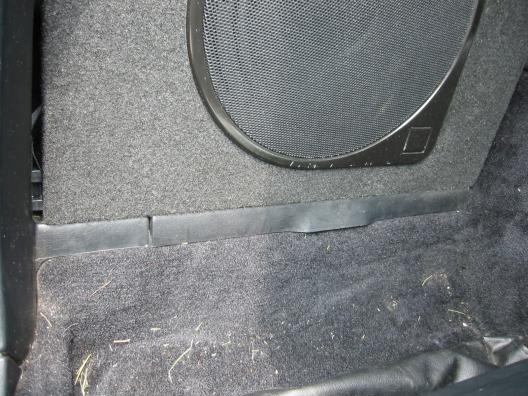 Sub enclosure fitment